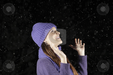Snowing at night stock photo, Snowing at night and happiness by Tom P.