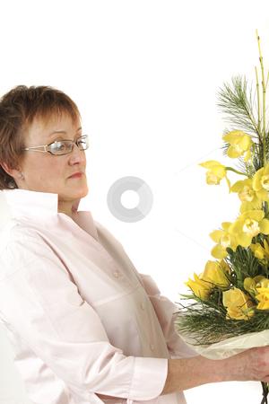 Florist stock photo, Elderly woman is preparing flower for Valentine's by Tom P.