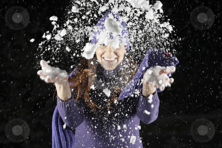 Snow stock photo, Snow from woman's hands in the night by Tom P.