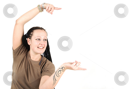 Young woman stock photo, Young woman shows something with tattooed hands by Tom P.