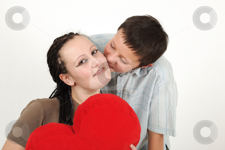 Young boy and girl stock photo, Young boy and girl with red heart by Tom P.