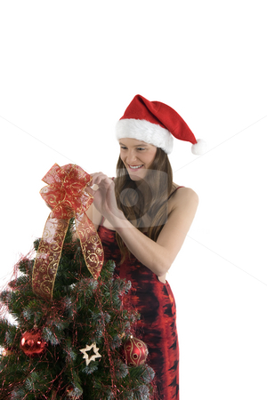 Christmas girl stock photo, Young girl is decorating the Christmas tree by Tom P.
