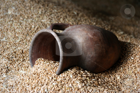 Clay pitcher stock photo, On a heap of grain the old jug lies by Aleksandr GAvrilov