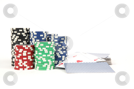 Poker chips and play cards stock photo, Amount of poker chips and play cards  on white background by Tom P.