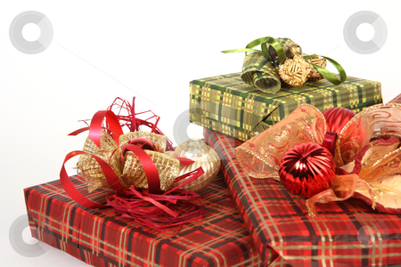 Presents stock photo, Three christmas present in red and green papers by Tom P.