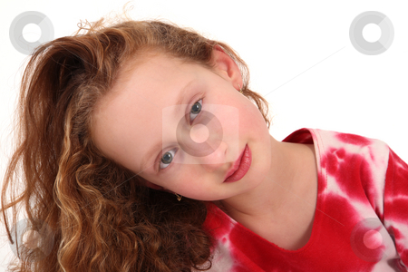 Gingery little girl  stock photo, Eight years old girl is moving her head by Tom P.