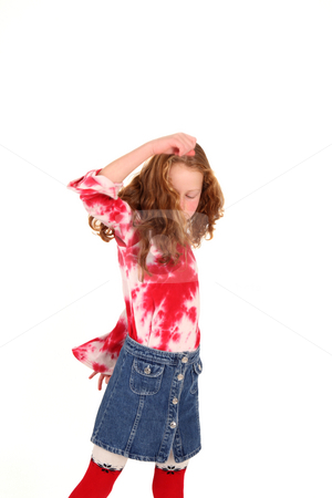 Little girl dancing stock photo, Young girl is turning around while dancing by Tom P.