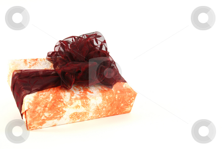 Christmas present stock photo, Christmas present in orange original paper with bordo tie by Tom P.