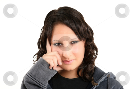 Teenage girl  stock photo, Teenage girl is looking directly into camera by Tom P.