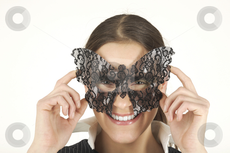 Young woman stock photo, Young woman in celebration mask by Tom P.