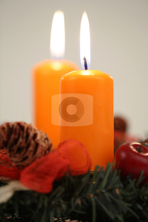 Two orange candles stock photo, Two orange candles on the advent wreath by Tom P.