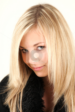 Portrait of young girl  stock photo, Teen girl is looking directly into camera and smiles by Tom P.