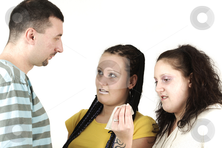 Condom problem stock photo, Three young people discuss about found condom by Tom P.