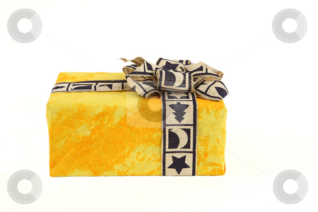 Christmas present stock photo, Christmas present in yellow original paper with beautiful ribbon by Tom P.