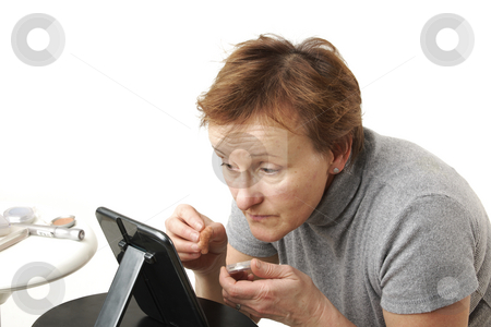 Make-up stock photo, Elderly woman prepares her selves for celebration by Tom P.