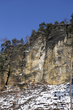 The rock stock photo, Winter landscape of high rocks by Tom P.