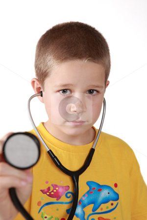 Young boy with auscultoscope stock photo, Young boy's direct look into camera with auscultoscope wearing by Tom P.