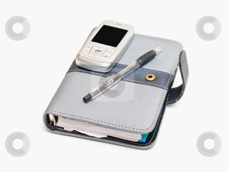 Business tools - Pen diary and a cell phone stock photo, Business tools - Pen  diary and a cell phone by Phillip Dyhr Hobbs