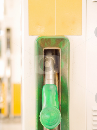 Service Station - Fuel nozzle with copyspace stock photo, Service Station -  Green Fuel nozzle with copy space by Phillip Dyhr Hobbs