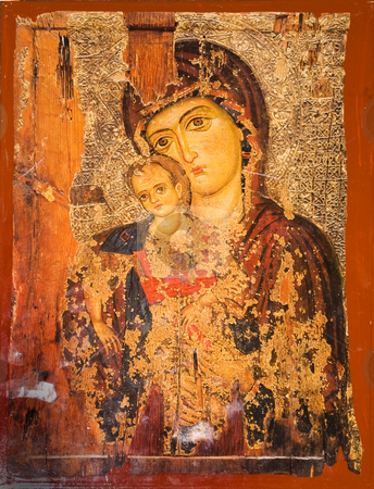 Icon paintings in monastery interior - virgin Mary and Jesus stock photo, Iconography painted icons with saints on monastery wall  by Desislava Dimitrova