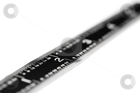 Shallow focus horizontal macro of a black ruler on white stock photo, Shallow focus horizontal macro of a black ruler on white by Vince Clements