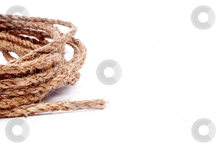 A horizontal view of a coil of rope on white with space for copy stock photo, A horizontal view of a coil of rope on white with space for copy by Vince Clements