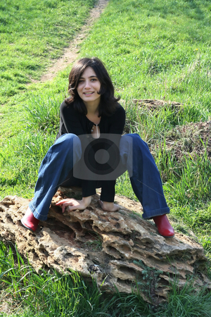 Cheerful stock photo, The cheerful girl sits on a stone by Aleksandr GAvrilov