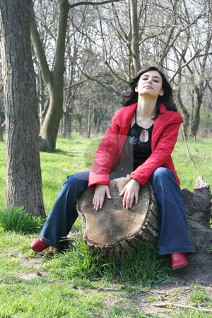 Hemp in wood stock photo, The nice girl sits on hemp in wood by Aleksandr GAvrilov