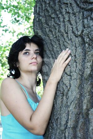 Embraced a tree stock photo, The beautiful girl has embraced a tree by Aleksandr GAvrilov