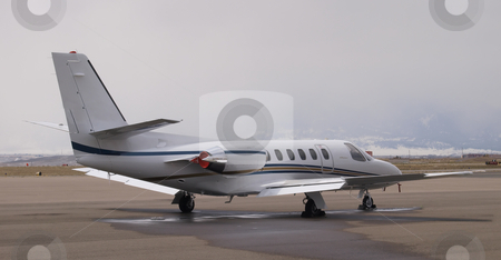 Corporate Jet stock photo, Parked jet on runway. by Michael Rice