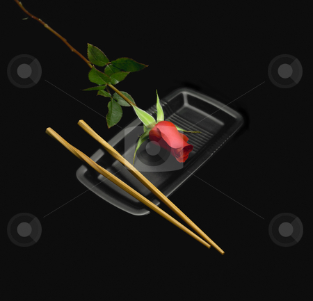 Red rose sushi stock photo, Red rose on a japanese plate with chopstick over black background by Francesco Perre