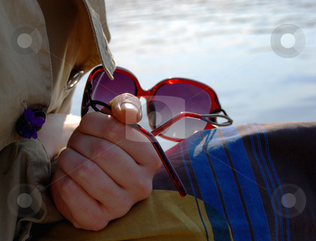 Sun glasses stock photo, Arm keeping sun glasses by Leyla Akhundova