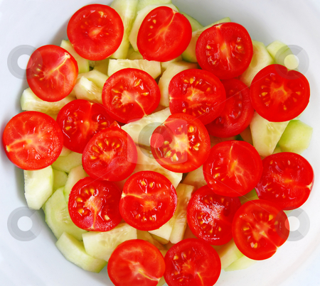 Cherry tomatoes stock photo, Red fresh cherry tomatoes salad with cucumbers by Julija Sapic