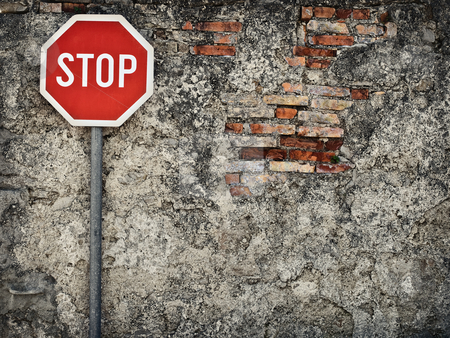 No way through stock photo, Stop sign against grungy wall, may represent protection,dead end,wrong way,ressistance... by Vladimir Koletic