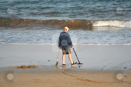 Treasure Hunting stock photo, Man searching for treasures at the end of the day by Helen Shorey