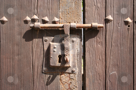 Old Fashioned Lock stock photo, Very old rusty lock on a wooden door to a courtyard garden in Teguise (Lanzarote) by Helen Shorey