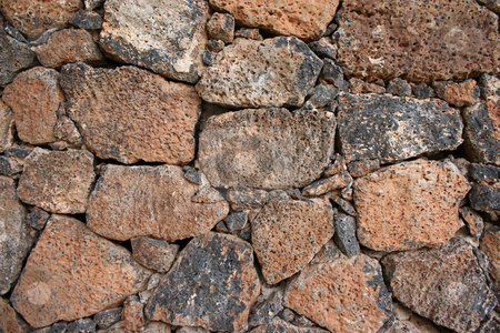 Volcanic Rock Wall stock photo, A dry stone wall built with chunks of volcanic rocks - typical of Lanzarote and other Canary Islands by Helen Shorey