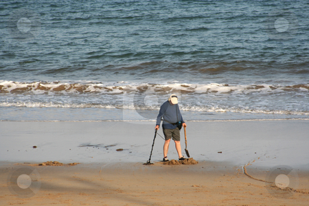Treasure Hunter stock photo, Looking for treasures at the end of the day once the tourists have left by Helen Shorey
