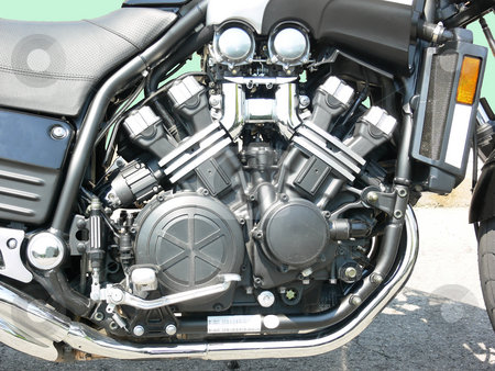 Motorbike    stock photo, A very clean 4 cylinder motorcycle engine on an parking lot. by Horst Petzold