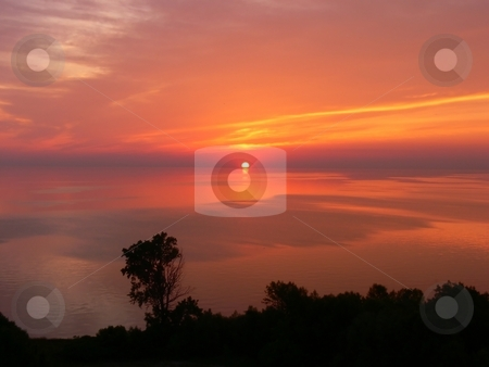 Sunrise    stock photo, The sun rises early in the morning over lake Ontario. by Horst Petzold