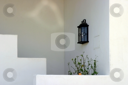 Light Reflections stock photo, Light with reflections on wall in a entrance way. by Henrik Lehnerer