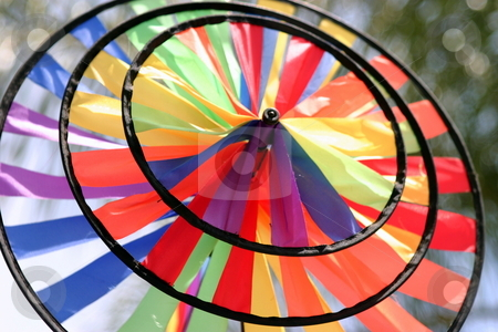 Wind Wheel stock photo, A round and colorful wind wheel made from fabric. by Henrik Lehnerer