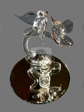 Love birds    stock photo, Two love birds made from crystal with gold edged wings and pikes on an  mirror and gray background. by Horst Petzold