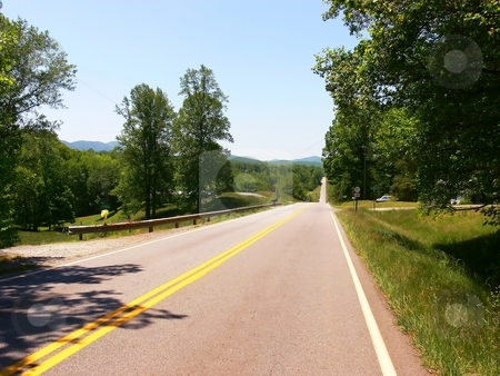 Highway to nowhere  stock photo, An strait highway through the beautiful green hills of Virginia. by Horst Petzold