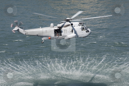 Helicopter over water stock photo, Helicopter over water by Stephen Gibson