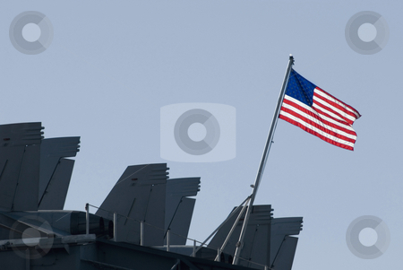 US NAVY stock photo, The stars and stripes flying from the back of the aircraft carrier kitty-hawk by Stephen Gibson