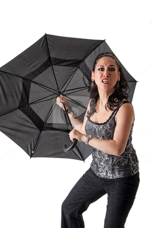 Mad woman with umbrella stock photo, Mad and crazy beautiful caucasian woman with umbrella, isolated by Paul Hakimata