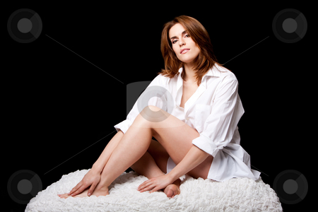 Sexy beautiful female  stock photo, Sexy beautiful brunette with mole on lip wearing a white shirt, natural and pure, sitting on a white cloud, isolated by Paul Hakimata
