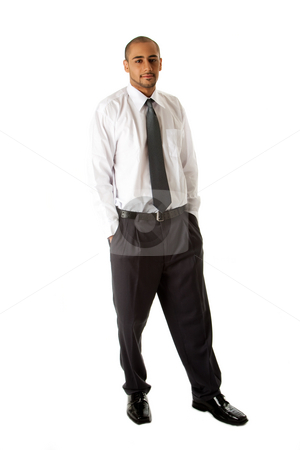 Handsome business man standing stock photo, Handsome African Hispanic business man in white shirt, gray pants and tie, standing with hands in pocket, isolated by Paul Hakimata