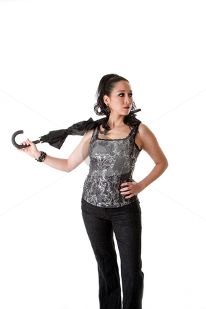 Beautiful female with umbrella stock photo, Beautiful caucasian female wearing gray tank top and jeans and hand on hip, carrying unbrella in neck, isolated by Paul Hakimata